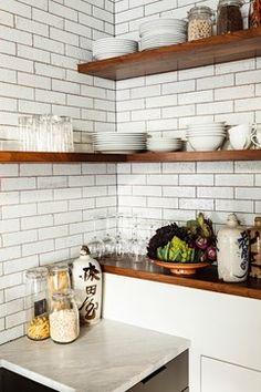 walnut shelves wrapping around with white subway backsplash