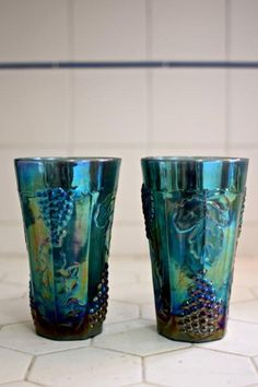 Blue Carnival Glass Tumblers.  My uncles earned pieces of this through their paper route and gave it to grandma.
