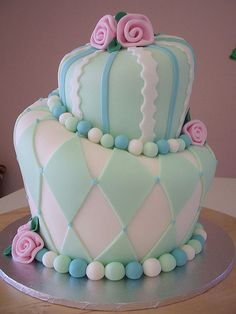 Pastel- I could definitely make a lopsided cake to decorate!!! lol