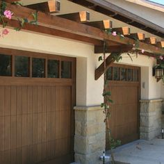 trellis over garage door: craftsman style stone details