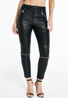 Take a walk on the wild side in a bold biker pant!The Biker PU Pants feature a structured waistband with belt loops, front zip pockets, moto and zip detailing along the leg, back pockets and hook and bar closure at the waist.Pair the look back with a basic tee.Model is wearing a size 10.Fabric Content: 55% Polyester, 45% CottonCoating: 100% PolyurethaneLining: 97% Polyester, 3% Elastane