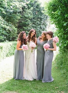 Bridesmaids wearing long grey maxi dresses. A bride with long dark loose hair and wearing Lazaro Perez. Fine art wedding photography by Polly Alexandre.