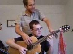 two people playing one guitar - Bing video