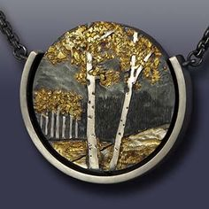 "Wolfgang Vaatz: , Pendant: gold nuggets from Rich Hill, AZ, and 14k gold fused on argentium silver, carved & engraved, oxidized. Attached to oxidized sterling silver chain with extension. 1.36"" h x 1.47"" w x 0.2"" d. 17-21"" chain."