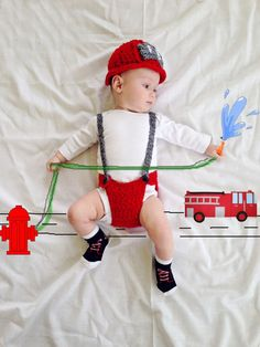 Firefighter baby photo. Fireman baby.  How to make cool baby pictures - DIY awesome baby photo - just lay your baby on a sheet and paint on the photo in any paint program on your computer. Unique Baby photos. Funny baby photos. 3 month old baby photo ideas. 6 month old baby photo ideas.