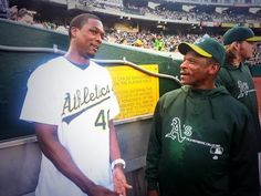 Following his first pitch, @Heather Barnes had his form analyzed by @Oakland Athletics legend Rickey Henderson.