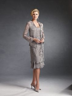 Two-piece silk burnout dress set, sleeveless knee-length soft A-line tank dress with a two tiered skirt trimmed with hand-beading, matching cardigan style jacket with beaded trim. Sizes:4 – 20, 16W – 26W Colors: Taupe