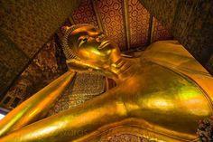 Photo @jasonedwardsng An enormous golden Reclining Buddha rises to a temple ceiling towering over worshippers and tourists alike. Wat Pho Temple of the Reclining Buddha #Bangkok #Thailand @natgeocreative @natgeo #buddha #prayer #religion #faith #buddhi