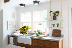 This classic kitchen design is understated yet stunning. From 1 of 11 projects by Foley & Cox Interiors, discovered on search.Porch.com #sunflowers #interiors #design #interiordesign