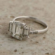 Vintage Emerald Cut Diamond Ring - Certified by the GIA - Estate Diamond Jewelry - Platinum mounting - VS1 clarity - Engagement Ring