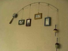 "fishing rod with photos and ""bait"" for the wall"