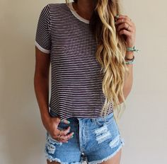 Black n white striped tee shirt and some blue, ripped, jeans shorts