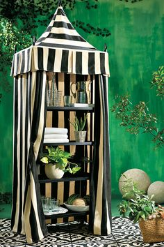 Outside rooms need focal points just like indoor ones. That's why we like using striped cabana to create special spaces tucked around your yard.