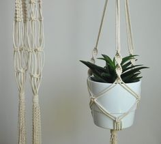 Must have for every plant lover - hanging macrame planter. Boho home decor addon, will change tha look of your home garden. READY TO SHIP  >> color: natural cotton/ecru/beige/linen  >> measurements:  white pot diameter 16cm (6,2 in) height 14 cm (5,5 in)  +/- couple centimeters smaller pots will also fit with no problem, slightly larger also but if you have much bigger pot ask for custom order I would love to make something especially for you :) The hanger is approximately 115cm / 45 inch…