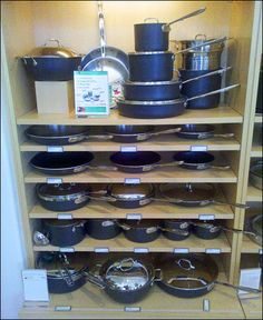 Williams Sonoma® Cookware Mass Merchandised By Shelf Kitchen Utilities, Homesense, Retail Store Design, Store Displays, Wood Shelves, Cool Kitchens, Decoration, Cookware, Kitchen Design