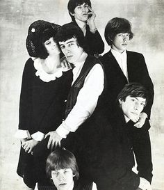 Photograph: Norman Parkinson from the April 1964 Queen magazine article 'How to Kill Five Stones with One Bird' featuring Nicole de la Marge with Rolling Stones Bill Wyman, Keith Richards, Mick Jagger, Charlie Watts and Brian Jones.