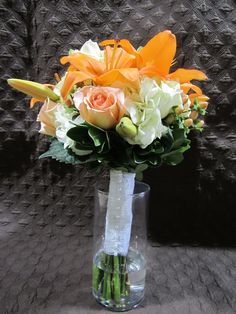 white hydrangea, orange asiatic lilies, peach hypericum berries, peach roses, green pitt