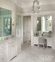 Stainback-Hess Studio - Stunning bathroom with mirrored chandelier over honed calcutta gold hexagon mosaic tile floor.
