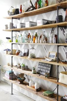 industrial shelving around window in kitchen floor to ceiling