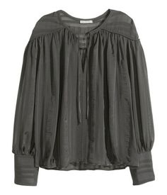 Dark gray/striped. Wide-cut V-neck blouse in textured chiffon with ties at neck and a yoke at back. Long sleeves with wide cuffs and without fasteners.