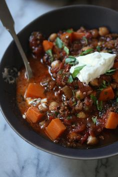 Gluten-Free Chili Recipe with Ground Lamb and Moroccan spices. Healthy with Greek yogurt instead of sour cream and lots of kale and sweet potatoes!