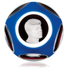 Baccarat 1964 faceted blue overlay John Fitzgerald Kennedy sulphide footed paperweight.