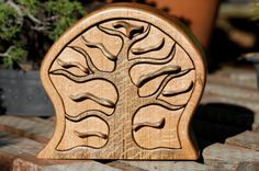 This shop does some incredible functional yet beautiful wood carvings, like this tree/jewelry box.