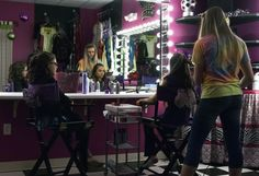 "11 year-old Saide (left) watches one of her friends get her hair done by stylist Sammy Kingry during her ""glamour girl"" birthday party at Sharkey's Cuts for Kids March 10, 2013. Photo: Steve Faulisi, San Antonio Express-News / ? 2013 San Antonio Express-News"