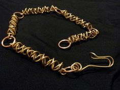 Choker formed by sections of coiled brass wire linked with copper rings. Handcrafted, one of a kind