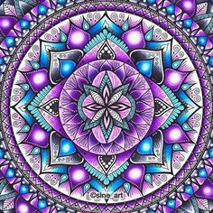 Beautiful purple, teal and pinks found in this mandala created with markers.