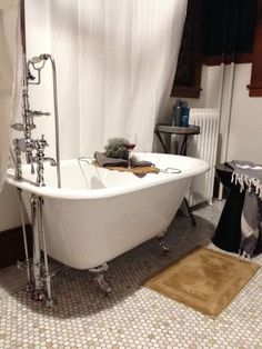 This space features a claw foot tub and accessible space for your favorite robe, soaps and glass of wine.