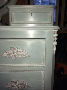 Victorian dresser with wishbone mirror. Chalk painted with a base coat of French Linen, top coat with Duck Egg Blue, color washed with Old White, and waxed with clear wax
