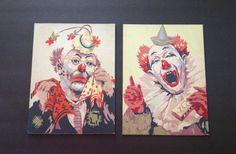 These are TWO vintage paint by number circus clowns. One clown is sad, holding a polka dot handkerchief. The other clown is laughing, holding a