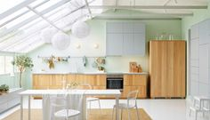 Sloping glass roof and solid part  The kitchen that thinks it's a living room
