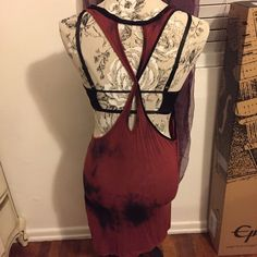 Tie Die, Twist Back Tunic Super cool tunic that would go great with a bralette and some black leggings. The colors are absolutely gorgeous. The black looks like smoke coming out of this maroon-rust color. Selling tunic only (not bralette). Open to offers. H&M Tops Tunics