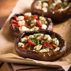 Stuffed Portobello mushrooms with goat cheese and roasted tomatoes, a savory appetizer or meatless main dish.