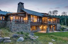 Big Sky Journal - A home designed byMiller Architects and built by On Site Management for a family with deep personal ties to the BigSky area references dude ranch cabins and rustic living while being carefully integrated into a forested site that boasts dramatic mountainviews.