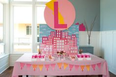 "Pink Superhero Party: LOVE the pink ombre cityscape backdrop and ""bat signal"" with custom monogram"