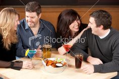 Real People: Young Adult Couples Night Out Bar Restaurant Royalty Free Stock Photo