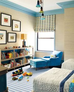 The armchair and ottoman in a Steven Gambrel-designed children's bedroom are custom made, the Roman shade is of a Quadrille linen, and the rug is by Patterson, Flynn & Martin.