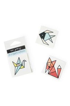 Put a spin on your traditional temporary tattoos with these origami-inspired animals from Wee Gallery. This set includes 3 sets of 4 tattoos: a crane a fish and a fox. These make wonderful party favors prizes or serve as a fun accessory for yourself.  Dimensions: (L x H) 2 x 2 in 5 x 5 cm  Origami Tattoos by Orikami. Home & Gifts - Gifts - Odds & Ends New York City