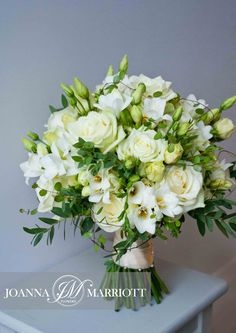 bridal bouquet composed of white roses, white freesia and cream lisianthus. Country Wedding Bouquets, Small Wedding Bouquets, Hydrangea Bouquet Wedding, White Wedding Flowers, Bride Bouquets, White Bridal, English Wedding, Lisianthus Bouquet, Bride Flowers
