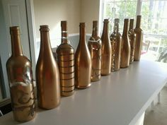 Painted wine bottles will be candle holder center pieces