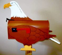 Eagle - Handcrafted and hand painted animal mailboxes by artist Michel Devost in Quebec. If you would like to order a special mailbox, contact Michel at http://pages.globetrotter.net/miche/mailboxes.html