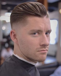 @blackfishbry Loose textured skin fade pompadour with a shaved in part