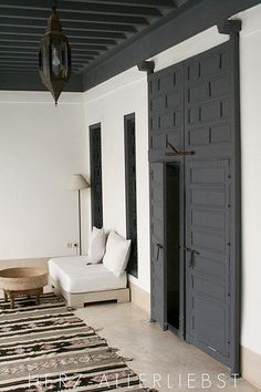 Beautiful black door on white wall