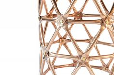 Geodesic Cylinder Table - 70 polished copper pipe struts form a base for a side table.