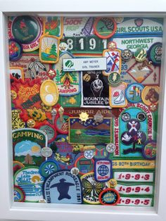 Display Girl Scout patches, badges, and awards. All hot glued to a fabric backer in a shadow box. Glued to the fabric, not on top of each other to avoid messing any of them up! Pins are punched all the way through the board backer or pinned through patch edges.