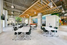 This unique space features sleek floors, modern office furniture, a colorful bar, reclaimed wood ceiling and hi-tech capabilities to create a meeting, conference and corporate event space unlike any other.