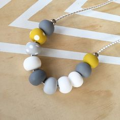 Polymer clay bead necklace. White grey mustard spot by RafHop